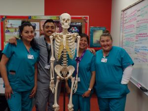 CNA students with skeleton